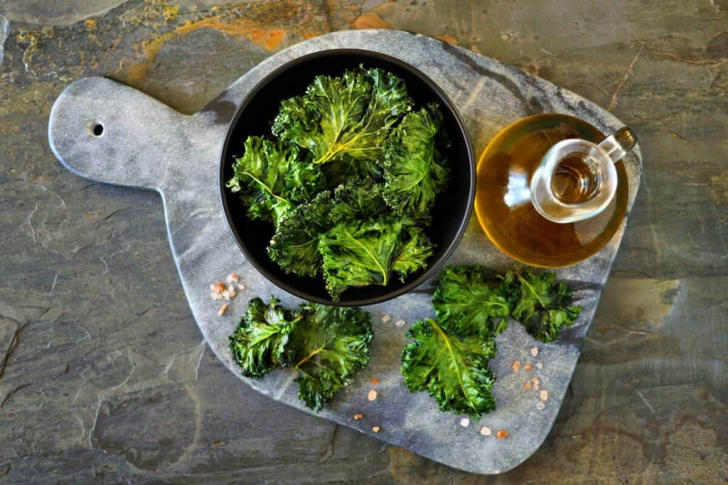 Green vegetables and dark leafy food background